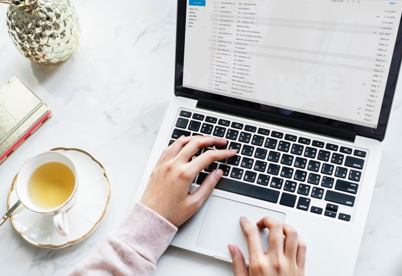 Woman working on laptop with cute desk accesories