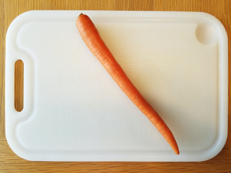 whole carrot on white cutting board