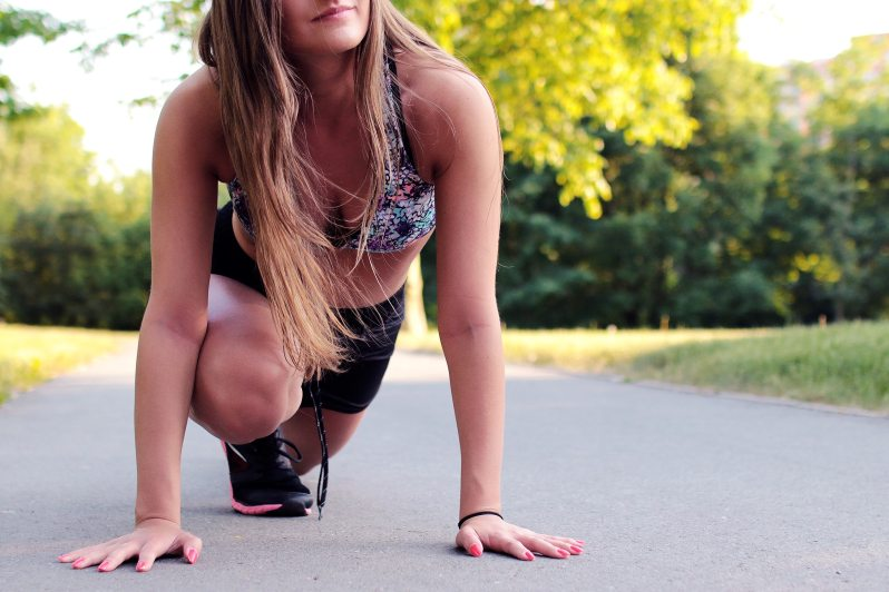 woman stretching on a path in the park